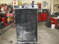 Oprava chladiče stavební stroj